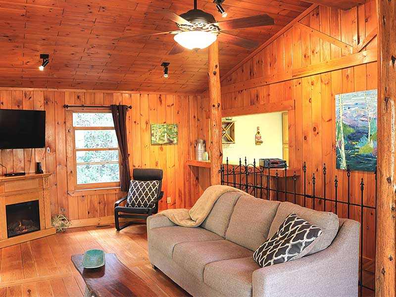 tongue and groove interior living room of The Historic Ol Gun Range large group cabin