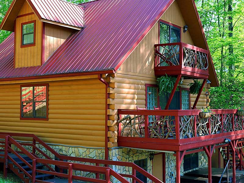 front view of the natural mountain larel deck railing of the authentic large group log cabin